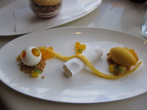 Decontructed Mango Cheesecake - Including a mango gel , passionfruit and mango fruit juice spheres, white chocolate cone and mango sorbet